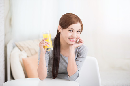 woman eat: Smile happy woman hold  orange juice at home, healthy lifestyle concept, asian beauty Stock Photo