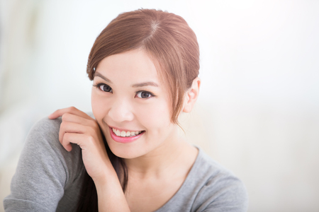 female beauty: smile young woman sit and look or think something at home, healthy lifestyle concept, asian beauty