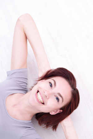 lie down: Close up portrait of a Happy young beautiful woman relax lying and smile to you, caucasian beauty Stock Photo