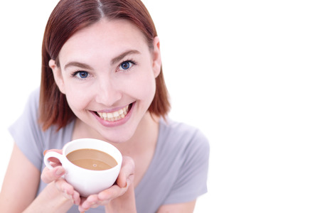 drink coffee: Close up portrait of a Happy young beautiful woman relax and drink coffee, caucasian beauty