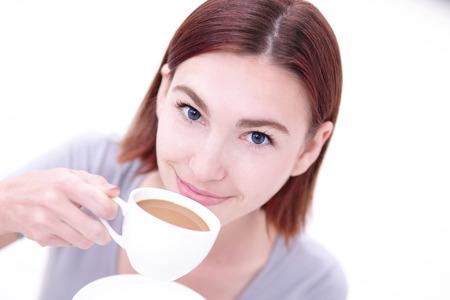 the caucasian beauty: Close up portrait of a Happy young beautiful woman relax and drink coffee, caucasian beauty