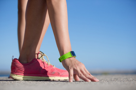 fit girl: Health sport woman wearing smart watch device with touchscreen doing exercises