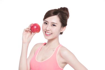 vitality: Happy health woman show apple benefit to health, asian beauty