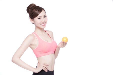 female beauty: Happy Woman show orange benefit to health, asian beauty