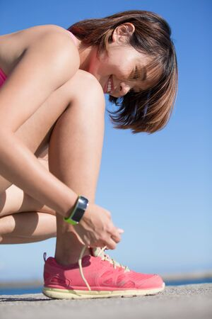 girl legs: Health sport woman wearing smart watch device with touchscreen doing exercises