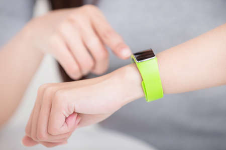 see: smile young woman use smart watch at home, healthy lifestyle concept, asian beauty