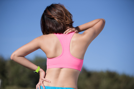 woman in pain: sport woman feel pain on neck and shoulder, health care concept, asian beauty Stock Photo