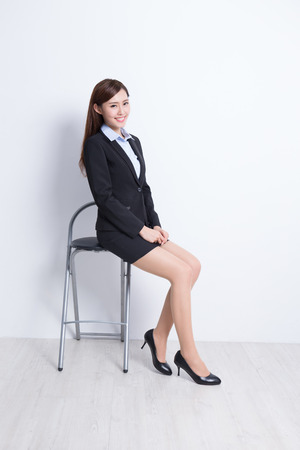 business woman: business woman sit on chair with white wall background, great for your design or text, asian beauty