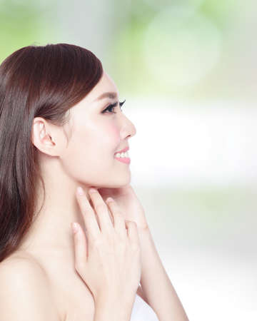 face side: profile of beauty woman with health skin, teeth and hair isolated on green background, asian beauty