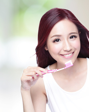 smile close up: Close up of Smile woman brush teeth. great for health dental care concept, Isolated over green background. asian