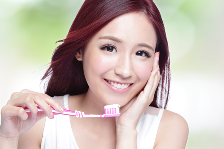dentistry: Close up of Smile woman brush teeth. great for health dental care concept, with nature green background. asian Stock Photo