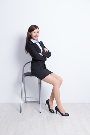 sit: business woman sit on chair with white wall background, great for your design or text, asian beauty