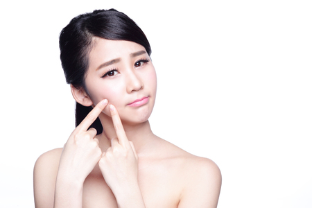 bad hygiene: Face Skin Problem - young woman unhappy touch her skin isolated, concept for skin care, asian