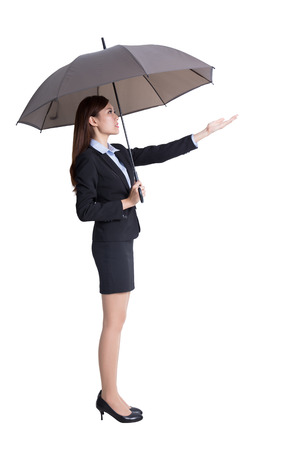 business woman holding umbrella isolated on white background, asian