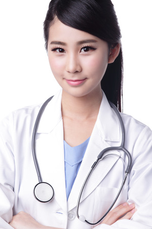 Smiling medical doctor woman with stethoscope. Isolated over white background. asian