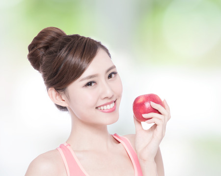manzana verde: Happy health woman show apple benefit to health with nature green background, asian beauty