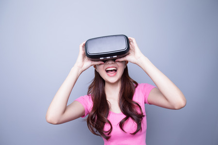 Excited happy woman watching the virtual reality headset, asian beauty Stock Photo