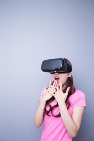 computer simulation: Afraid woman watching the virtual reality headset, asian beauty