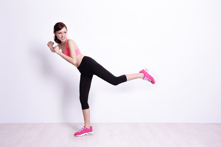 sport woman is doing exercise with white wall background,asian beauty