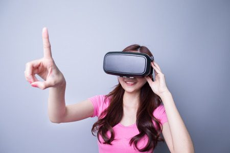 gesticulating: Smile happy woman getting experience using VR-headset glasses of virtual reality at home much gesticulating hands, asian beauty Stock Photo
