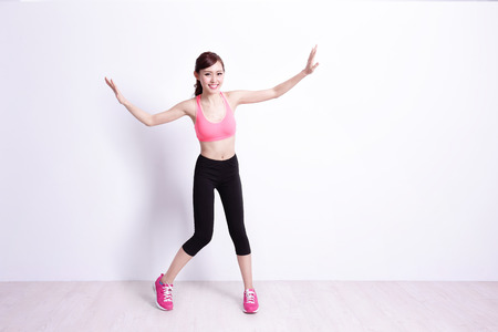 happy asian people: sport woman is doing exercise isolated on the white background,asian beauty