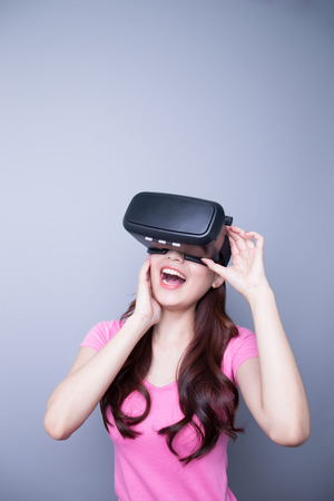 virtual reality simulator: Excited happy woman watching the virtual reality headset, asian beauty Stock Photo