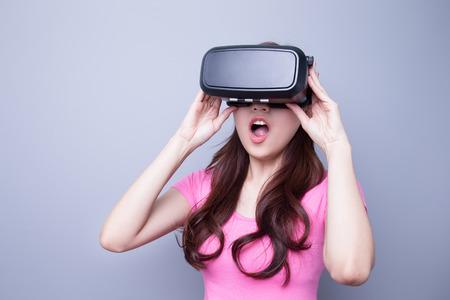 Afraid woman watching the virtual reality headset, asian beauty