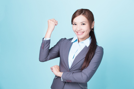 happy work: Smile business woman isolated on blue background, asian female