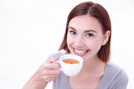 hot drink: smile young woman holding cup of  tea, healthy lifestyle concept