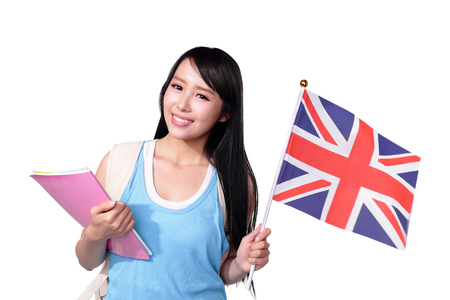 british girl: Happy College Student girl hold British flag. Isolated on white background, asian Stock Photo