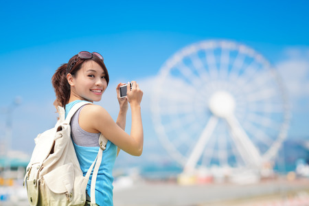 asia women: Happy woman travel with ferris wheel, hong kong, asian beauty
