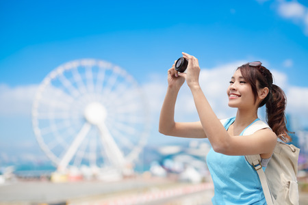 Happy woman travel with ferris wheel, hong kong, asian beauty