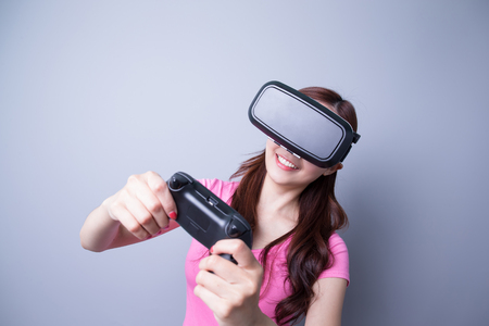 virtual reality simulator: Happy woman playing games with the virtual reality headset, Asian beauty Stock Photo