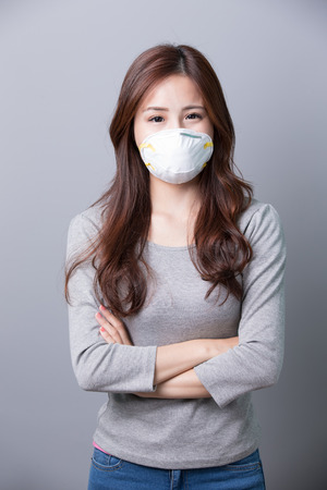 cross arms: A Woman wears a mask and cross arms, illness, asian beauty Stock Photo