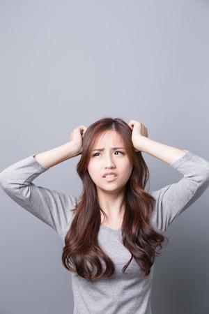A Woman feel headache, illness,asian beauty,gray background