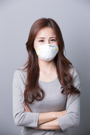 cross arms: A Woman wears a mask  and cross arms, illness, asian