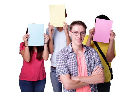 white face: Friend group of happy student holding empty copy space billboard paper isolated over a white background,  caucasian