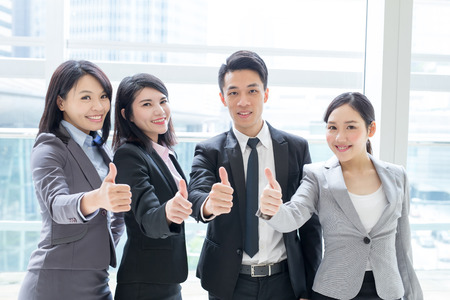 asia business: Group of success business people team show thumb up in office, asian Stock Photo