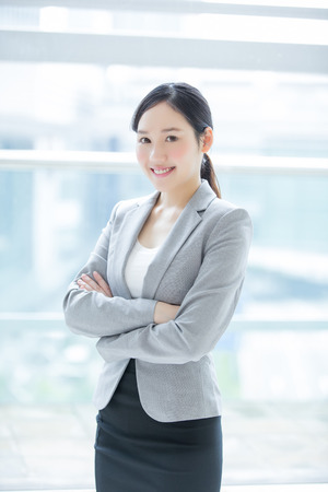 business woman smile in office with window, asian beauty