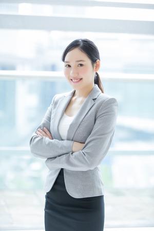 woman window: business woman smile in office with window, asian beauty