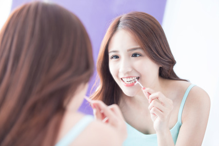 dental health: Close up of Smile woman clear teeth by floss and look mirror. great for health dental care concept. asian beauty