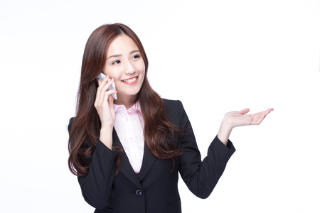 young executive: Young Business woman show empty copy space and smile talking on the mobile phone isolated on white background, model is a asian beauty Stock Photo