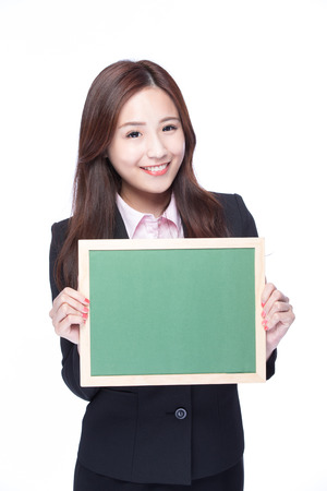 asia women: smile young business woman hold chalkboard at white background, business concept, asian beauty Stock Photo