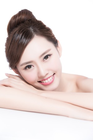 charming girl: Charming woman face Smile to you close up while lying isolated on white background, asian girl Stock Photo