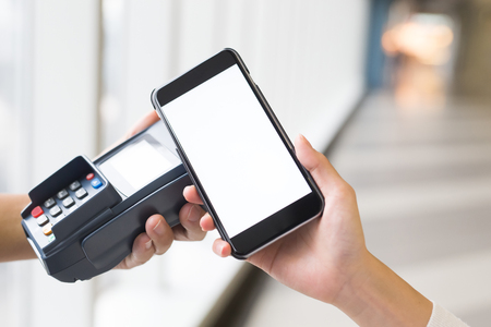 contactless: Customer pay by cellphone with empty screen, great for your design Stock Photo