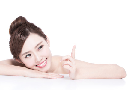 Charming woman Smile and show something while lying isolated on white background, asian girl