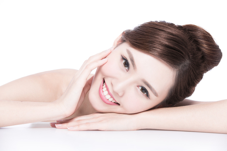 beautiful teeth: Charming woman face Smile to you close up while lying isolated on white background, asian girl Stock Photo