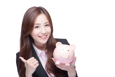 chinese lady: Happy business woman smiling holding pink piggy bank and show thumb up isolated on white background. Asian girl Stock Photo