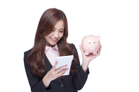 asia women: smile young business woman hold calculator and piggy bank at white background, business concept, asian beauty Stock Photo