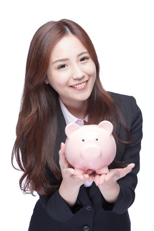 business money: Savings woman smiling happy and holding pink piggy bank isolated on white background. Asian girl